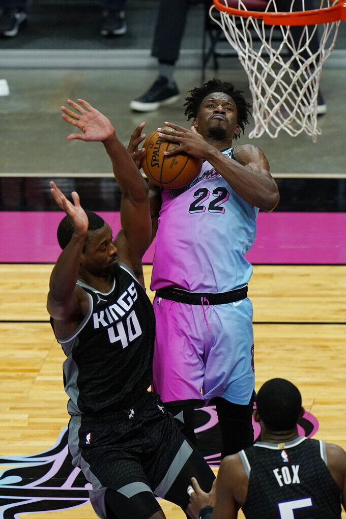 Sacramento Kings forward Harrison Barnes (40) fouls Miami Heat forward Jimmy Butler (22) as he drives to the basket during the second half of an NBA basketball game, Saturday, Jan. 30, 2021, in Miami. (AP Photo/Marta Lavandier)
