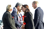 Britain's Prince William, right, watches as New Zealand's Prime Minister Jacinda Ardern, second right, is greeted with a hongi, a traditional Maori greeting, by Te Maire Tau of Ngai Tuahuriri Maori group, as they arrive in Christchurch, New Zealand, Thursday, April 25, 2019. Prince William is on a two-day visit to New Zealand to take part in ANZAC ceremonies and visit the two mosques where a gunman killed 50 people on March 15. (Hannah Peters/Pool via AP)