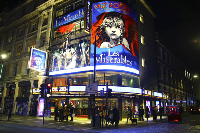 People leave the Sondheim Theatre, in London, where