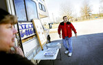 Sabine, left, and Jeff Cool watch as fellow food trucks pull into a lot all vying for a smaller-than-normal lunch crowd outside a NASA complex in Huntsville, Ala., Wednesday, Jan. 9, 2019. Today, people and businesses which rely on that federal largesse for their livelihood are showing the strain of a government shutdown.