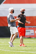 Cleveland Browns owner Jimmy Haslam, left, talks with head coach Kevin Stefanski during practice at the NFL football team's training facility Friday, Aug. 14, 2020, in Berea, Ohio. (AP Photo/Ron Schwane)