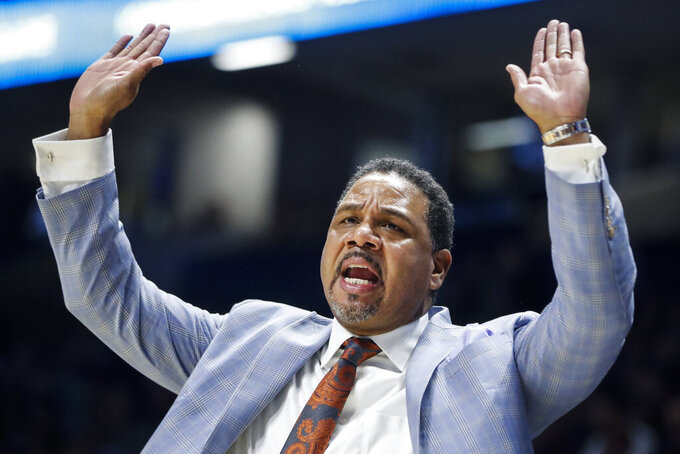 Providence head coach Ed Cooley reacts in the first half of an NCAA college basketball game against Xavier, Wednesday, Jan. 23, 2019, in Cincinnati. (AP Photo/John Minchillo)