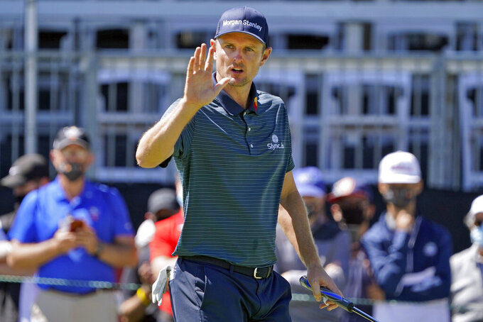Justin Rose, of England, waves to the gallery after putting out on the ninth hole during the first round of the Arnold Palmer Invitational golf tournament Thursday, March 4, 2021, in Orlando, Fla. (AP Photo/John Raoux)