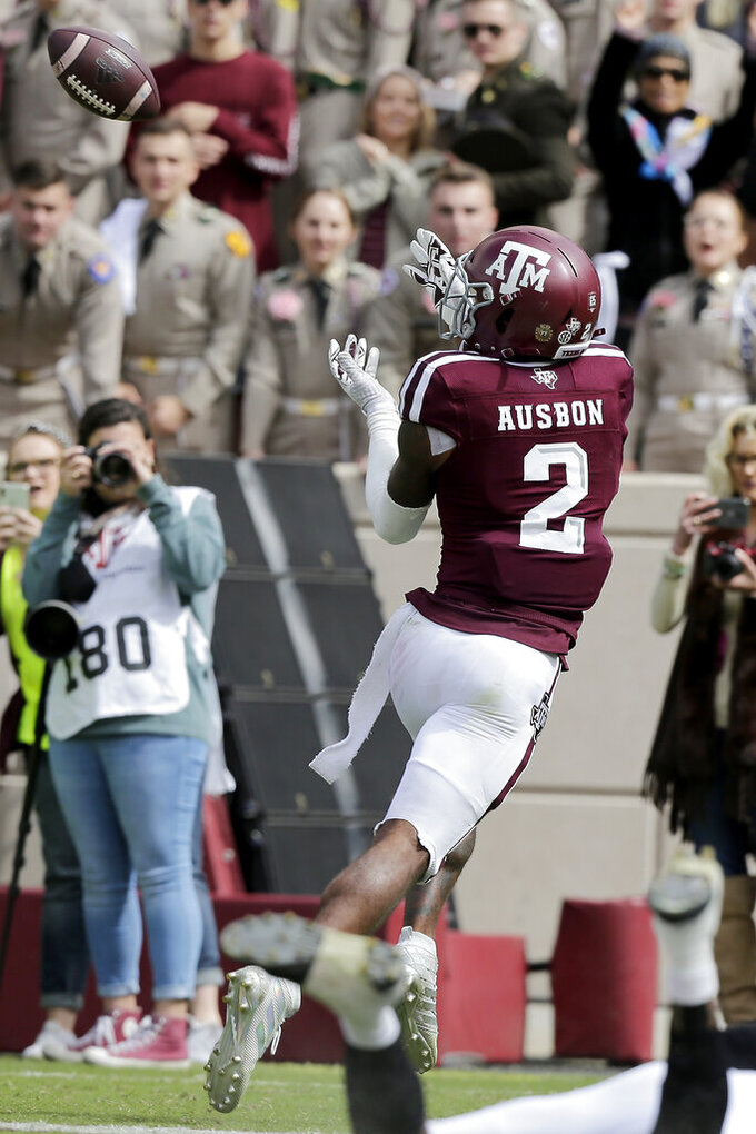 Texas A&M wide receiver Jhamon Ausbon (2) catches a pass for a touchdown against Mississippi State during the first half of an NCAA college football game, Saturday, Oct. 26, 2019, in College Station, Texas. (AP Photo/Sam Craft)