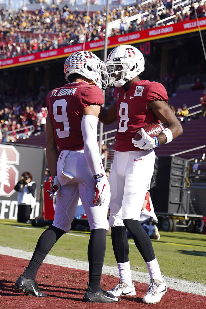 Stanford wide receiver Donald Stewart (8) celebrates with teammate Osiris St. Brown (9) after scoring a touchdown against California during the first half of an NCAA college football game Saturday, Nov. 23, 2019 in Stanford, Calif. (AP Photo/Tony Avelar)