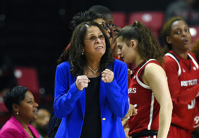 FILE - In this Dec. 31, 2018, file photo, Rutgers head coach C. Vivian Stringer reacts in the final minutes of an NCAA college basketball game against Maryland in Baltimore. Rutgers won, 73-65. Coach Stringer, who earlier this season posted her 1,000th victory, is taking off the rest of the regular season on the advice of doctors. The announcement Sunday, Feb. 24, 2019, by the Big Ten Conference school came three days after the 70-year-old Hall of Famer missed a game at Michigan. (AP Photo/Gail Burton, File)