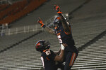 Oregon State offensive linesman Joshua Gray (67) lifts Oregon State running back Jermar Jefferson (6) into the air after Jefferson scored a touchdown during the second half of an NCAA college football game against Washington State in Corvallis, Ore., Saturday, Nov. 7, 2020. Washington State won 38-28. (AP Photo/Amanda Loman)