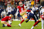 San Francisco 49ers' Robbie Gould (9) kicks the game-winning field goal from the hold of Mitch Wishnowsky, left, during the team's NFL football game against the Los Angeles Rams in Santa Clara, Calif., Saturday, Dec. 21, 2019. (AP Photo/John Hefti)