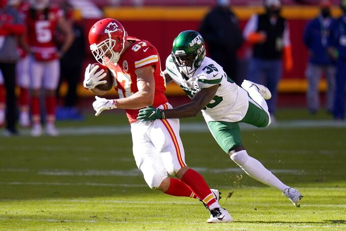 Kansas City Chiefs tight end Travis Kelce (87) catches a pass for a first down as New York Jets cornerback Pierre Desir (35) works to make the stop in the second half of an NFL football game on Sunday, Nov. 1, 2020, in Kansas City, Mo. (AP Photo/Jeff Roberson)