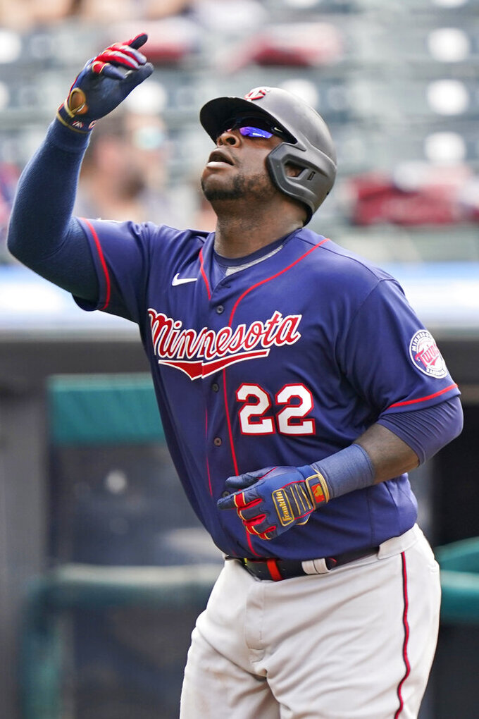 Minnesota Twins' Miguel Sano reacts after hitting a solo home run in the fourth inning of a baseball game against the Cleveland Indians, Saturday, May 22, 2021, in Cleveland. (AP Photo/Tony Dejak)