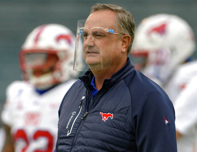 FILE - In this Oct. 16, 2020, file photo, SMU head coach Sonny Dykes watches his team during an NCAA college football game against Tulane in New Orleans.  A meeting of undefeated Group of Five teams when No. 9 Cincinnati plays the No. 16 Mustangs on Saturday, Oct. 24, 2020, the American Athletic Conference's top defense trying to stop one of the league's best offenses, and the first game matching Top 25 teams since SMU (5-0, 3-0 AAC) resumed playing on campus three decades ago. (AP Photo/Matthew Hinton, File)