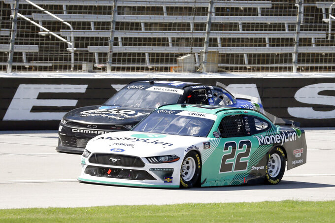 Austin Cindric heads down the front stretch during the NASCAR Xfinity auto race at Texas Motor Speedway in Fort Worth, Texas, Saturday, July 18, 2020. Cindric was named the winner of the race after Kyle Busch (not pictured) was disqualified after the race. (AP Photo/Ray Carlin)