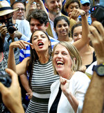 Alexandria Ocasio-Cortez, center, the surprise winner in the congressional race who unseated 20-year incumbent Joe Crowley in New York's Congressional District 14, points to Zephyr Teachout while endorsing her candidacy for Attorney General during a press conference, Thursday, July 12, 2018, in New York. (AP Photo/Bebeto Matthews)