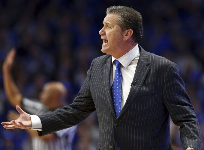 Kentucky coach John Calipari yells to his team during the second half of an NCAA college basketball game against Vanderbilt in Lexington, Ky., Saturday, Jan. 12, 2019. Kentucky won 56-47. (AP Photo/James Crisp)