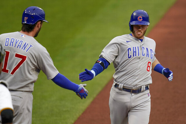 Chicago Cubs' Ian Happ, right, is greeter by on-deck batter Kris Bryant, left, after hitting a solo home run against the Pittsburgh Pirates in the first inning of a baseball game, Tuesday, Sept. 1, 2020, in Pittsburgh. (AP Photo/Keith Srakocic)