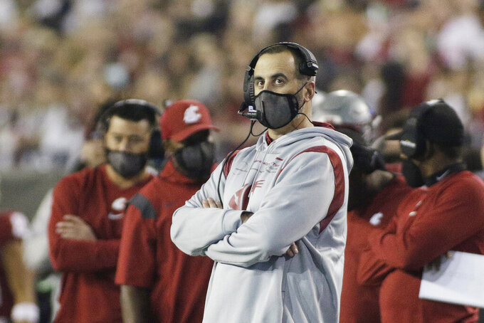 Washington State head coach Nick Rolovich looks on during the second half of an NCAA college football game against Utah State, Saturday, Sept. 4, 2021, in Pullman, Wash. Utah State won 26-23. (AP Photo/Young Kwak)