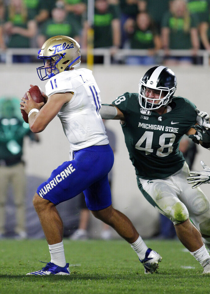 Michigan State's Kenny Willekes, right, sacks Tulsa quarterback Zach Smith during the fourth quarter of an NCAA college football game, Friday, Aug. 30, 2019, in East Lansing, Mich. (AP Photo/Al Goldis)