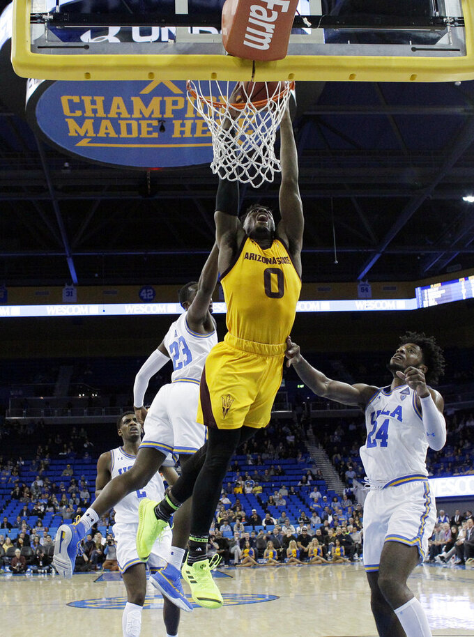 Arizona State guard Luguentz Dort (0) dunks against UCLA during the second half of an NCAA college basketball game Thursday, Jan. 24, 2019, in Los Angeles. (AP Photo/Marcio Jose Sanchez)