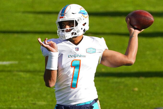 Miami Dolphins quarterback Tua Tagovailoa (1) warms up prior to an NFL football game against the Denver Broncos, Sunday, Nov. 22, 2020, in Denver. (AP Photo/Jack Dempsey)
