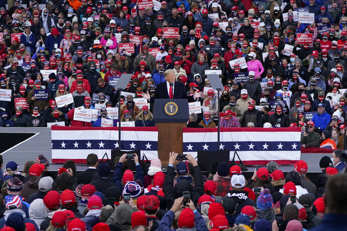 President Donald Trump speaks at a campaign rally, Saturday, Oct. 17, 2020, in Norton Shores, Mich. (AP Photo/Carlos Osorio)