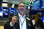 Trader Edward Curran works on the floor of the New York Stock Exchange, Friday, July 23, 2021. Stocks rose in early trading on Wall Street Friday and put the major indexes on track for a strong finish in a week that opened with a stumble. (AP Photo/Richard Drew)