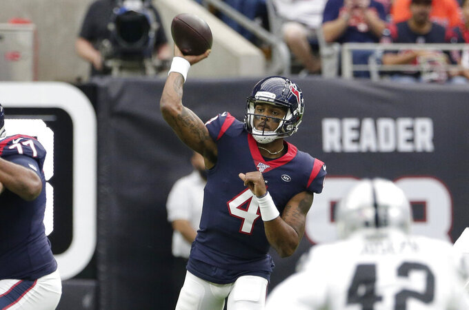 Houston Texans quarterback Deshaun Watson (4) throws against the Oakland Raiders during the first half of an NFL football game Sunday, Oct. 27, 2019, in Houston. (AP Photo/Michael Wyke)