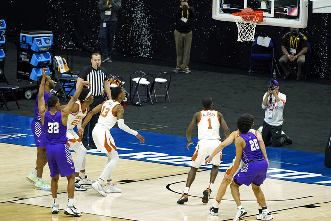 Abilene Christian's Joe Pleasant (32) makes a free throw to give Abilene Christian a 53-52 win over Texas in the first round of the NCAA tournament at Lucas Oil Stadium in Indianapolis Sunday, March 21, 2021. (AP Photo/Mark Humphrey)
