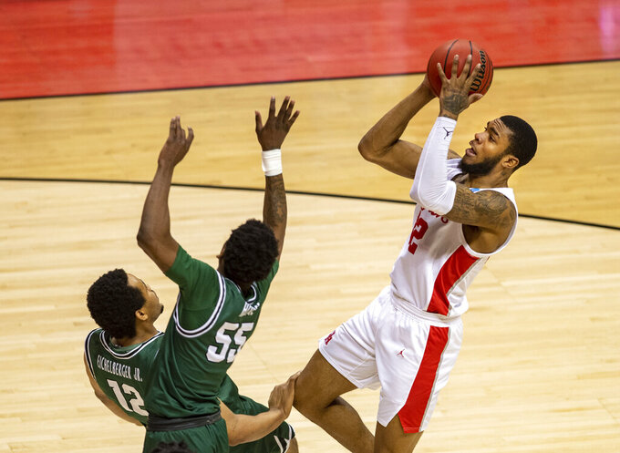 Houston guard Tramon Mark (12) puts up a shot during the second half of a first-round game against Cleveland State in the NCAA men's college basketball tournament, Friday, March 19, 2021, at Assembly Hall in Bloomington, Ind. (AP Photo/Doug McSchooler)