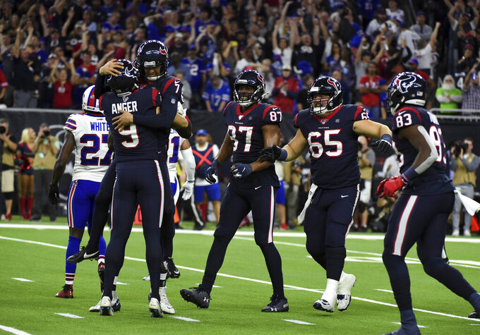 Houston Texans kicker Ka'imi Fairbairn (7) celebrates with Bryan Anger (9) after kicking the game-winning field goal against the Buffalo Bills during overtime of an NFL wild-card playoff football game Saturday, Jan. 4, 2020, in Houston. The Texans won 22-19. (AP Photo/Eric Christian Smith)