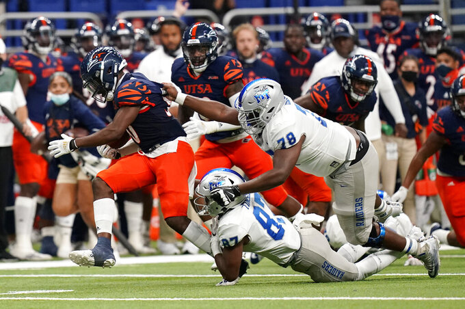 UTSA safety Donyai Taylor (30) is pursued by Middle Tennessee wide receiver Marquel Tinsley (87) and offensive lineman Dorian Hinton (78) after making an interception during the first half of an NCAA college football game, Friday, Sept. 25, 2020, in San Antonio. (AP Photo/Eric Gay)
