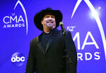 FILE - Singer/songwriter Garth Brooks appears at the 52nd annual CMA Awards in Nashville, Tenn. on Nov. 14, 2018. Brooks says he is pulling himself out of nominations for the Country Music Association's entertainer of the year award, saying it's time for someone else to win the top prize. Brooks, who won the top prize last November, said during an online press conference on Wednesday that he doesn't want to be nominated in any upcoming years as well. (Photo by Evan Agostini/Invision/AP, File)