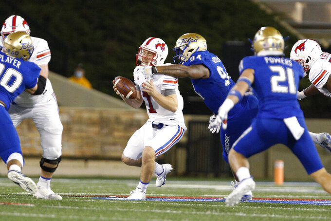 Tulsa defensive lineman Anthony Goodlow (94) sacks SMU quarterback Shane Buechele (7) during the first half of an NCAA college football game in Tulsa, Okla., Saturday, Nov. 14, 2020. (AP Photo/Joey Johnson)