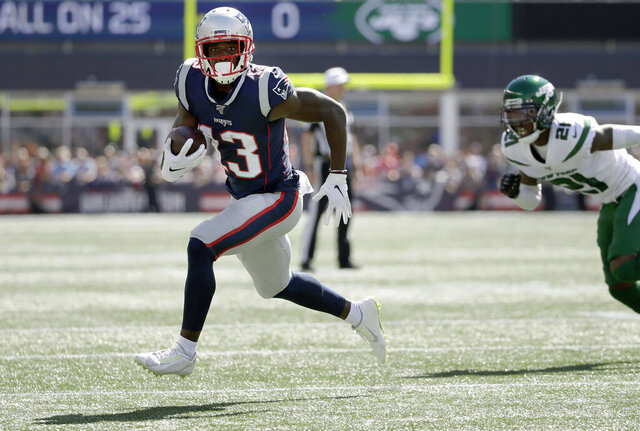 FILE - In this Sept. 22, 2019, file photo, New England Patriots wide receiver Phillip Dorsett, left, runs from New York Jets cornerback Nate Hairston (21) on the way for a touchdown after a reception during an NFL football game in Foxborough, Mass. Dorsett has never set foot in Seattle or anywhere in the Pacific Northwest. Not as a player in either of his previous NFL stops. Not in college. Not just for a random trip. He hasn't even seen in person the the place he'll practice after signing with the Seattle Seahawks whenever the facility becomes available to use. (AP Photo/Elise Amendola, File)