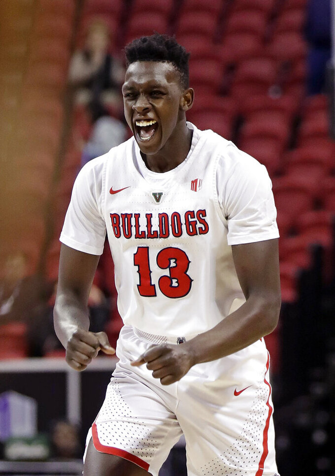 Fresno State's Aguir Agau reacts to a basket during the second half of an NCAA college basketball game against Air Force in the Mountain West Conference men's tournament Thursday, March 14, 2019, in Las Vegas. (AP Photo/Isaac Brekken)