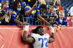 Los Angeles Rams offensive guard Tremayne Anchrum (72) poses with fans after an NFL preseason football game against the Denver Broncos, Saturday, Aug. 28, 2021, in Denver. The Broncos won 17-12. (AP Photo/David Zalubowski)