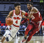 Mississippi guard Breein Tyree (4) drives against Arkansas guard Jimmy Whitt Jr. (33) during an NCAA college basketball game in Oxford, Miss., Saturday, Jan. 11, 2020. (Bruce Newman/The Oxford Eagle via AP)