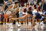 Villanova forward Jeremiah Robinson-Earl (24) lunges for the ball as Saint Joseph's forward Myles Douglas (2) evades during the second half of an NCAA college basketball game, Saturday, Dec. 7, 2019, in Philadelphia. Villanova won 78-66. (AP Photo/Laurence Kesterson)