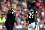 Manchester United manager Ole Gunnar Solskjaer, left, instructs Aaron Wan-Bissaka from the touchline during the English Premier League soccer match against Southampton at St Mary's, Southampton, England, Saturday Aug. 31, 2019. (Mark Kerton/PA via AP)