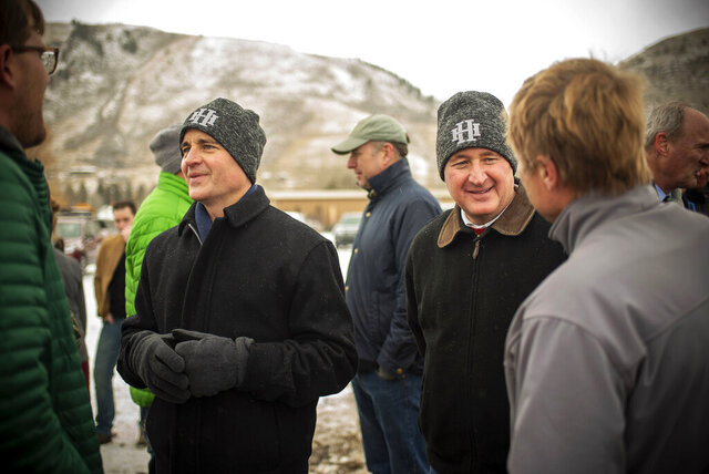 This Dec 18, 2017, photo shows Hidden Hollow apartment complex owners Kirk Hansen, left, and Jim Hansen Jr. at the groundbreaking for the development in Jackson, Wyo. The brothers were killed Nov. 30, 2019, near Chamberlain, S.D., in a plane crash with several other family members. (Bradly J. Boner/Jackson Hole News & Guide via AP)
