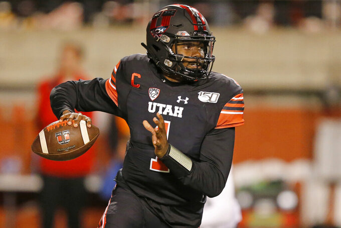 Utah quarterback Tyler Huntley (1) looks down field in the first half of an NCAA college football game against California Saturday, Oct. 26, 2019, in Salt Lake City. (AP Photo/Rick Bowmer)