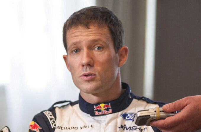 "FILE - In this Thursday, Jan. 25, 2018 file photo, French driver Sebastien Ogier on M-Sport Ford speaks to the media prior to the start of the 86th Monte Carlo Rally, in Monaco. Citroen is withdrawing from next year's world rally championship following the decision of six-time world champion Sebastien Ogier to leave the team. The French car manufacturer said in a statement on Wednesday, Nov. 20, 2019 it decided to stop its rally program ""due to the absence of a first-class driver available for the 2020 season."" (AP Photo/Christian Alminana, File)"