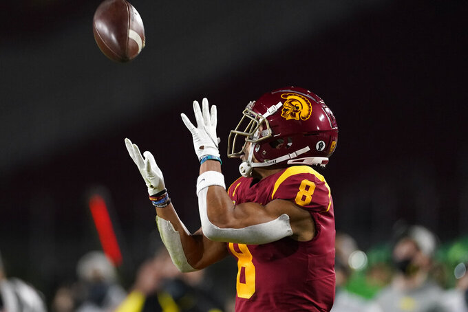 Southern California wide receiver Amon-Ra St. Brown (8) catches a pass before running to the end zone for a touchdown during the first quarter of an NCAA college football game for the Pac-12 Conference championship against Oregon Friday, Dec 18, 2020, in Los Angeles. (AP Photo/Ashley Landis)
