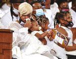 Tomika Miller, the wife of Rayshard Brooks, weeps while holding their 1-year-old daughter Dream during his funeral in Ebenezer Baptist Church on Tuesday, June 23, 2020 in Atlanta. Brooks, 27, died June 12 after being shot by an officer in a Wendy's parking lot.  (Curtis Compton/Atlanta Journal-Constitution via AP, Pool)