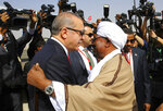 FILE - In this Dec. 24, 2017, file photo, Turkey's President Recep Tayyip Erdogan, left, and Sudan's President Omar al-Bashir greet each other in Khartoum, Sudan. As the uprising against Sudanese President Omar al-Bashir gained strength, Egypt, the United Arab Emirates and Saudi Arabia began reaching out to the military through secret channels to encourage his removal from power. They had long viewed al-Bashir as a problem because of his close ties to Islamists, and had grown weary of his shifting loyalties and outreach to their rivals, Turkey and Qatar. (Kayhan Ozer/Pool Photo via AP, File)