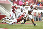 Alabama receiver Irv Smith Jr. slips past Arkansas defender Santos Ramirez in the first half of an NCAA college football game Saturday, Oct. 6, 2018, in Fayetteville, Ark. (AP Photo/Michael Woods)