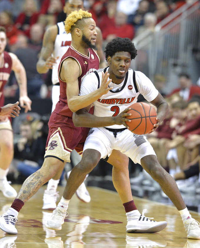 Boston College guard Ky Bowman (0) pressures Louisville guard Darius Perry (2) for the ball during the first half of an NCAA college basketball game in Louisville, Ky., Wednesday, Jan. 16, 2019. (AP Photo/Timothy D. Easley)