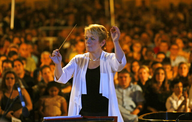 FILE - This Oct. 9, 2015 file photo shows Marin Alsop conducting a concert in Cathedral Square in Havana, Cuba. Alsop has been hired as the first chief conductor of the Ravinia Festival, the summer home of the Chicago Symphony Orchestra. The 63-year-old was given a two-year appointment. (AP Photo/Desmond Boylan, File)