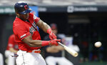 Cleveland Indians' Yasiel Puig hits an RBI-single in the first inning in a baseball game against the Minnesota Twins, Friday, Sept. 13, 2019, in Cleveland. Oscar Mercado scored on the play. (AP Photo/Tony Dejak)