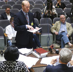 Will Lawrence, an attorney and aide to the Kansas Senate's top Democrat, testifies during a hearing on his legal challenge to independent candidate Greg Orman's right to be on the ballot in the governor's race, Thursday, Aug. 23, 2018, in Topeka, Kan. The board hearing the challenge ultimately rejected most of Lawrence's issues, allowing Orman to remain on the ballot. (AP Photo/John Hanna)