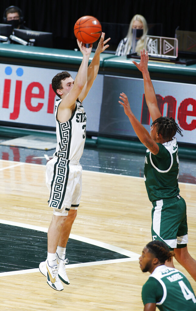 Michigan State's Foster Loyer, left, shoots against Eastern Michigan's Drew Lowder during the first half of an NCAA college basketball game Wednesday, Nov. 25, 2020, in East Lansing, Mich. (AP Photo/Al Goldis)